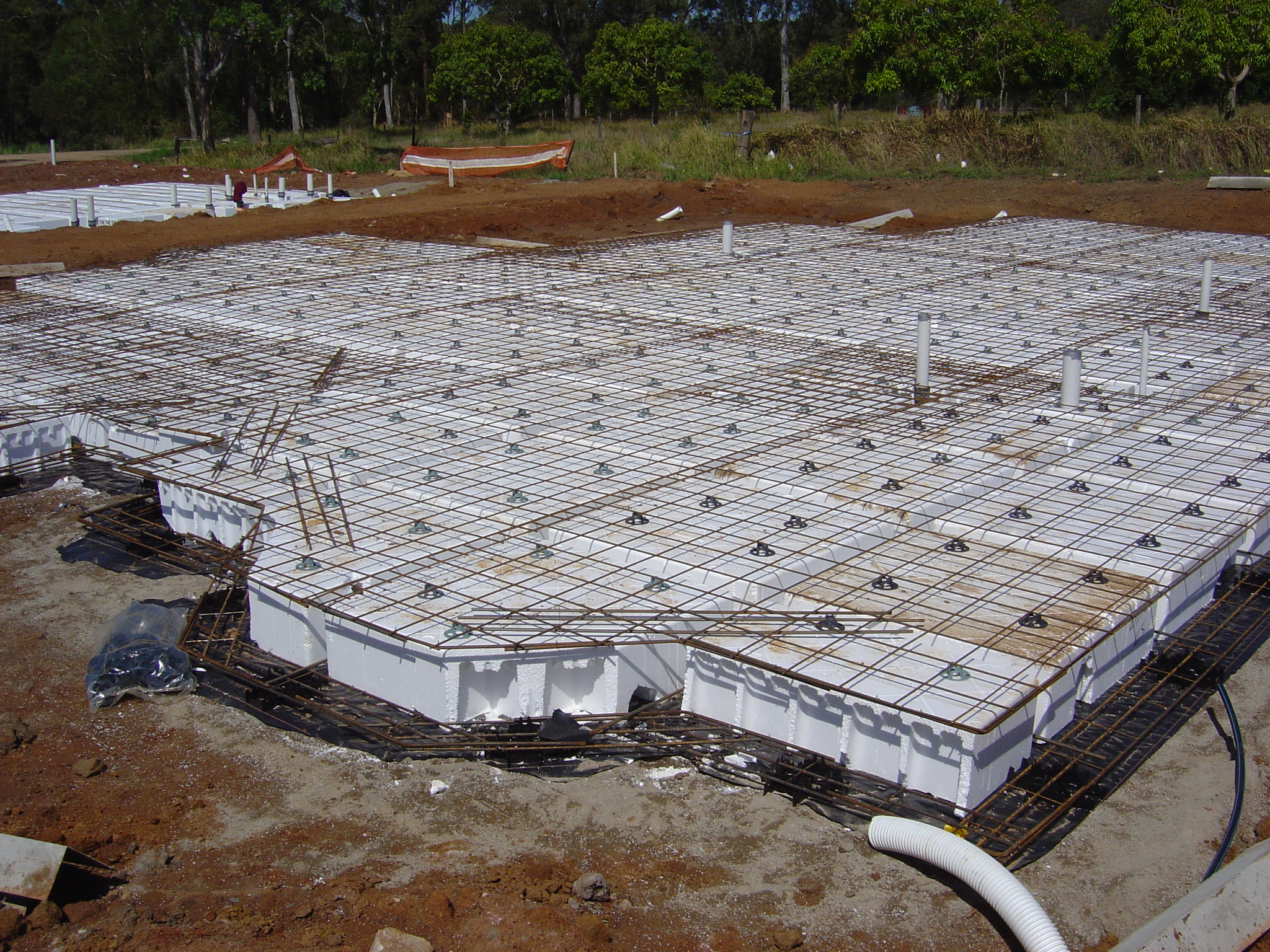 Eps pods and waffle raft slabs blog expanded polystyrene for Building a house on a slab